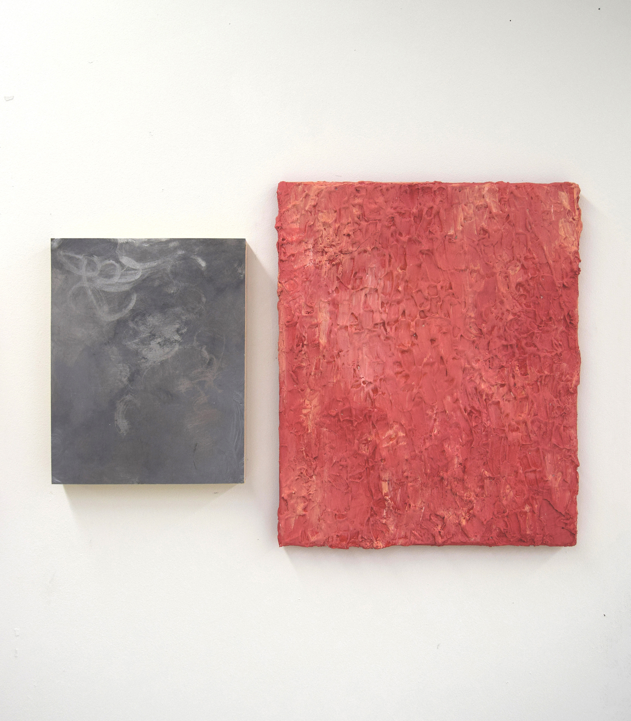 Two paintings, one metal and one is a paint textural one