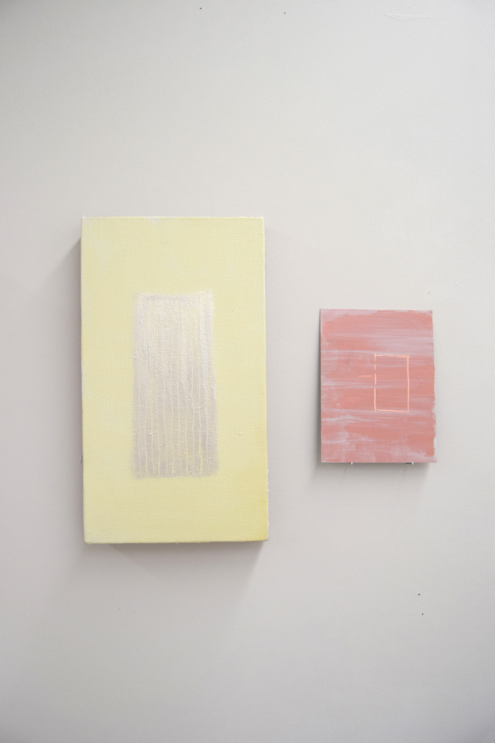 Two paintings, one is yellow with a shimmery centre and the other is copper with a rectangle scratched in